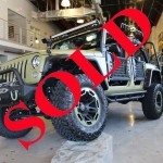 "2014 ARMY GREEN JEEP WRANGLER UNLIMITED SPORT WITH 2.5"" LIFT AND 35"" TIRES"