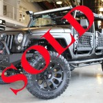 2014 BLACK JEEP WRANGLER UNLIMITED SPORT WITH 2.5″ LIFT AND 35″ TIRES