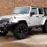 2010 SILVER JEEP WRANGLER UNLIMITED SAHARA WITH 3″ LIFT AND 35″ TIRES - $24,995