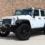 2016 WHITE JEEP WRANGLER UNLIMITED SPORT WITH 2.5″ LIFT AND 35″ TIRES - $41,995