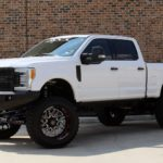 """2019 WHITE FORD F250 FX4 CREW CAB 4X4 WITH 8"""" LIFT AND 40"""" TIRES - $89,995"""