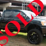 "2010 NISSAN TITAN 4X4 PRO-4X CREW CAB 6"" LIFT AND 37"" TIRES"