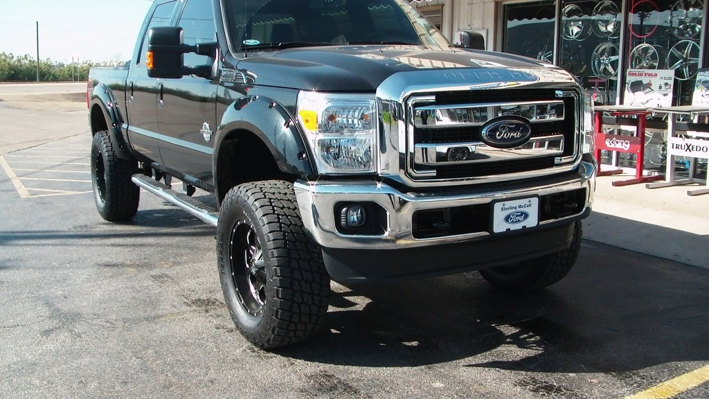 Black Lifted Ford Super Duty With Fuel Wheels And Off Road