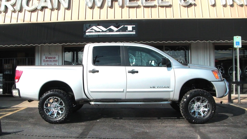 Lifted Silver Nissan V8 Titan With Ballistic Jester Wheels