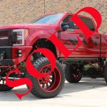 "2017 RUBY RED FORD F250 PLATINUM FX4 CREW CAB 4X4 WITH 10-12"" AIR SUSPENSION LIFT AND 42"" TIRES"
